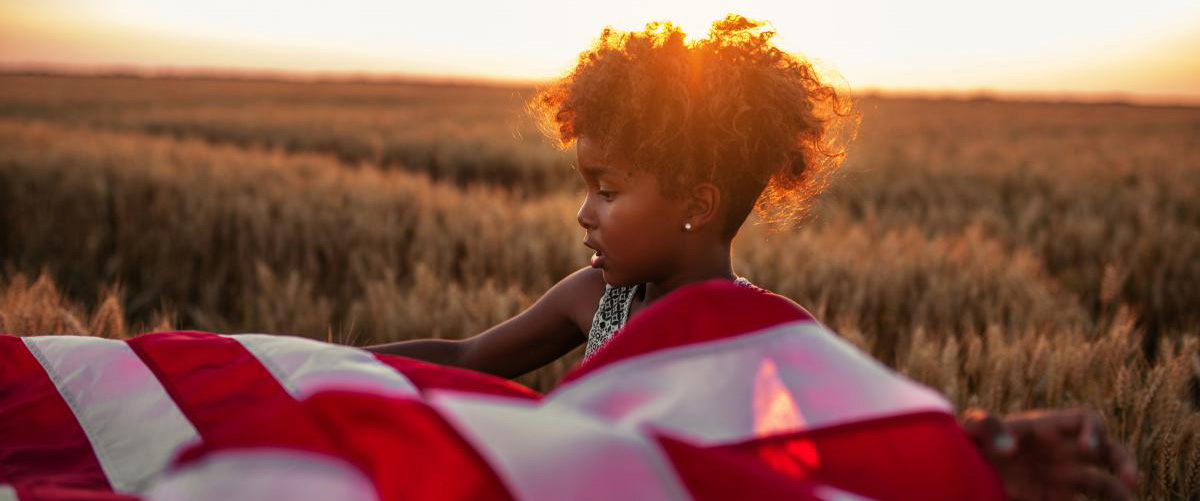 young girl with the us flag
